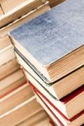 pile of weathered old books - stock photo