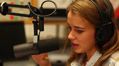 Pretty student presenting a radio show Stock Footage