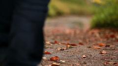 Man walking along a leafy path Stock Footage