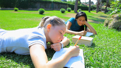 Three good looking students in park Stock Footage