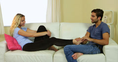 Stock Video Footage of Caring boyfriend giving his pretty girlfriend a foot rub