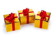 three gold gift boxes - stock photo