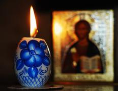 Candle and orthodoxy icon Stock Photos
