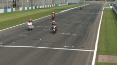 Donnington park above the track on gantry Motorbike racing Stock Footage