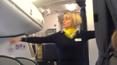 flight attendant in airplane - stock footage