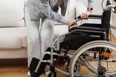 Sitting down on wheelchair Stock Photos