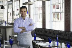 A cafe interior A man in chef's whites - stock photo