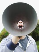 A man using a megaphone in the open air Stock Photos
