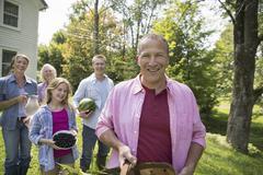Family summer gathering farm homecoming picnic Stock Photos