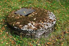 typical concrete water well with moss - stock photo