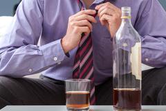 Businessman afterwork drinking Stock Photos