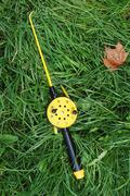 fishing rod with yellow reel - stock photo