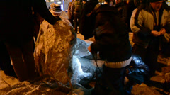 People near destroyed statue of Lenin during Euro-maidan in Kiev, Ukraine. Stock Footage