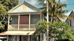 KeyWest 055HD, Pan between two typical Houses in the Duval Street Stock Footage