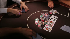 Casino. A group of adults playing texas holdem poker Stock Footage