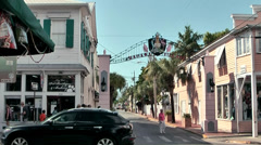 KeyWest 047HD, Crossing in the Duval Street, colonial Style Houses at the Corner Stock Footage