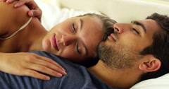 Cute couple sleeping and cuddling in bed Stock Footage