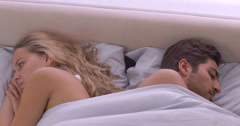 Couple lying in bed not talking after a fight Stock Footage