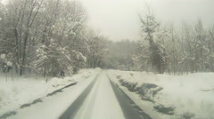 Driving in snowfall pov Stock Footage