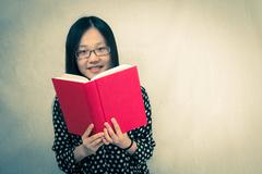 girl reading a red book - stock photo
