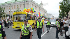 Bus gay parade participants and huge police force protect Stock Footage