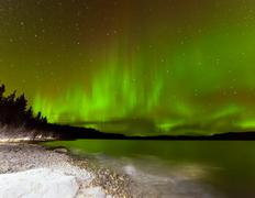 aurora borealis night sky over lake laberge yukon - stock photo