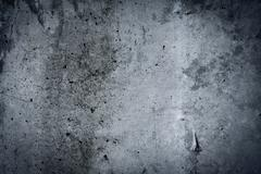 Vintage grey painted plaster concrete wall background. dark edged Stock Photos