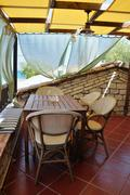 veranda with drapes and sea view - stock photo
