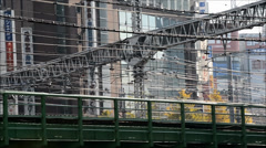Railway with wiring and buildings in the background, Shinjuku, Tokyo - stock footage