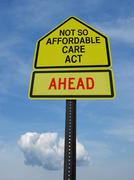 Not so affordable care act ahead sign Stock Photos