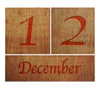 wooden calendar december 12. - stock illustration