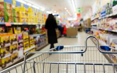 View from shopping cart trolley at supermarket shop. retail. Stock Photos