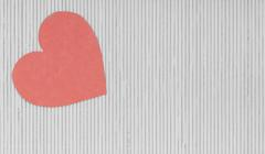 Stock Photo of red heart love symbol on grey gray bamboo mat valentines day