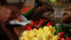 Chef preparing fresh fruit plate Stock Footage