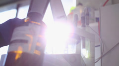 Chemical lab work in the sunshine Stock Footage