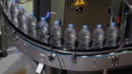 Stock Video Footage of Plastic water bottles on conveyor or water bottling machine