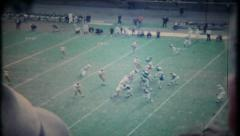 737 - professional football game in large stadium - vintage film home movie Stock Footage