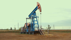 Work of oil pump jack on a oil field. Stock Footage