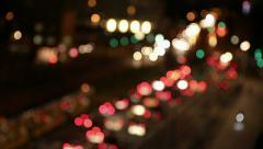 Defocusing cars at night traffic in city Stock Footage
