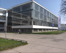 Bauhaus school building with transparent glass facade by Walter Gropius + pan - stock footage