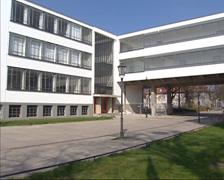 Bauhaus school building entrance + pan transparent glass facade + pan traverse Stock Footage