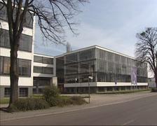 street Gropius Allee + pan Bauhaus college complex - stock footage