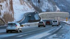 Traffic trucks cars mountain winter highway travel HD 0226 - stock footage