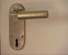 Gropius door handle, designed by Walter Gropius - door swings open - on camera Stock Footage