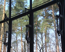 Mechanically open and close steel framed windows Stock Footage