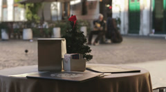 Table of a restaurant in rome with small christmas tree, street artist Stock Footage