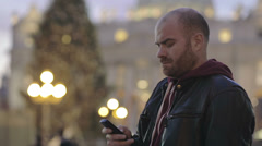 Tourist in Rome sends a sms with the cell phone from St. Peter's Square Stock Footage