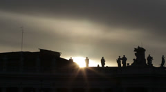 Silhouette of the colonnade of St. Peter's Square against the sun - backlight Stock Footage