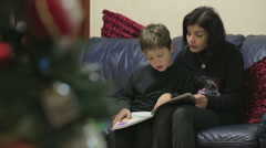 Mom and little son reading the stories about the legend of the Christmas Stock Footage