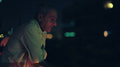 poor old man absorbed by his thoughts - on the balcony on Christmas Eve - stock footage